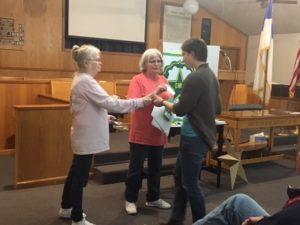 Lila Echert receiving her GMA award from Shelia Polk and Karen Magee